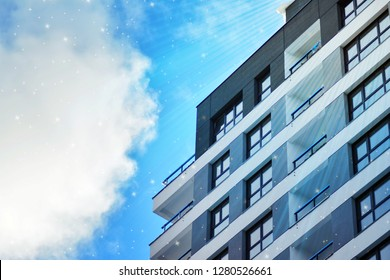 Sky with the stars above a multi-storey residential building.