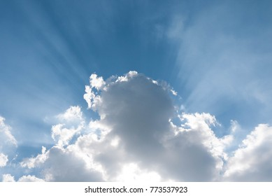 Sky with sun beam dramatically burst from behind clouds.