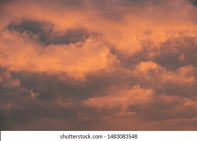 Sky at sunrise. Skyscape with bright pink clouds