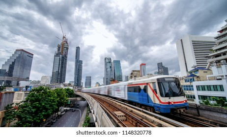 Sky train, mass transportation pass through skycrapers business building in central business district of Bangkok, Thailand
