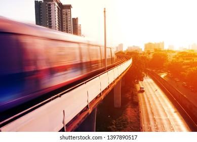 sky train on the rail and sun flare