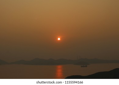 The sky turned orange red as the day closes in a hazy sunset in Hong Kong.