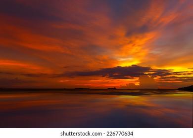 Sky in twilight  sunset  on sea coast with water reflex
