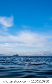 Sky, water and fishing boat