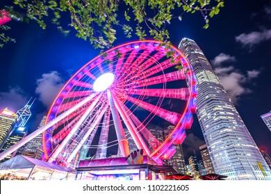 sky wheel with hongkong skyline