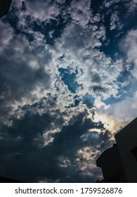 The sky when it rains. Stromy dark clouds mixed up with light blue clouds and a little sunshine adding beauty in this picture. - Shutterstock ID 1759526876