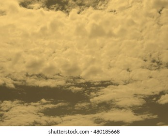 sky with white clouds useful as a background vintage sepia