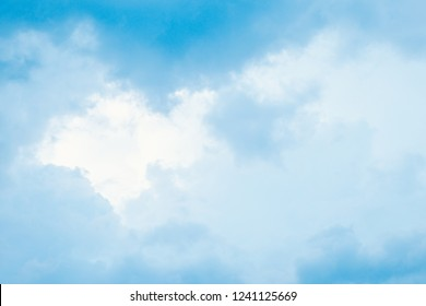 Sky-blue light fluffy clouds in sky with copy space. For background and wallpaper