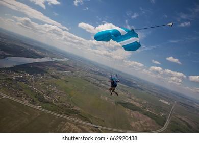 Skydive. Man under parachute. Aerograd Kolomna, Russia