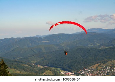 Skydive, man under a parachute in the sky