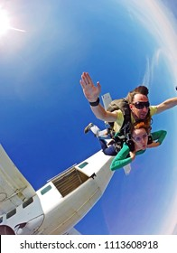 Skydive tandem couple jump out the plane