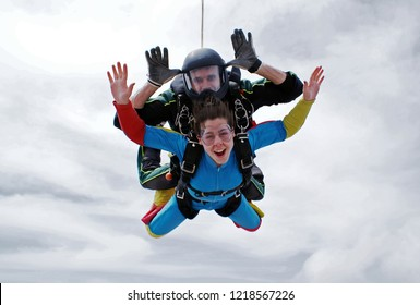 Skydive tandem happy cloudy day