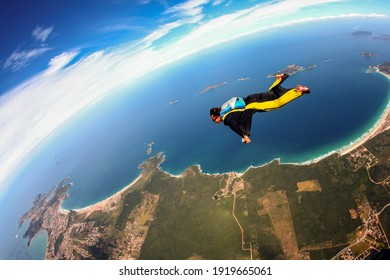 Skydive wing suit flying over Brazilian beach, adventure freedom concept