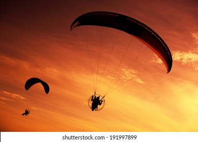 Skydiver against sunset