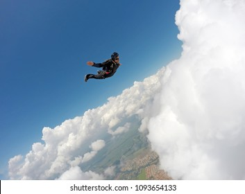 Skydiver Cloudscape speed dive to the ground