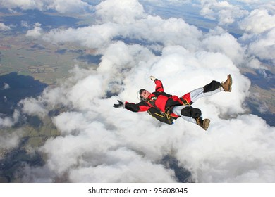Skydiver falling on his back through the air