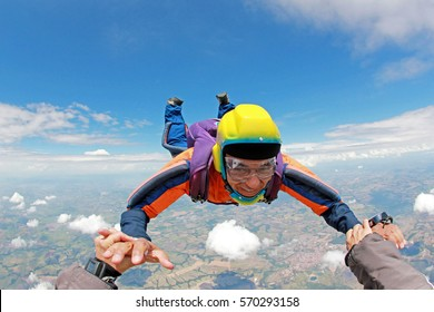 Skydiver senior man, smiling in free fall