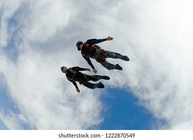 Skydivers diving fast