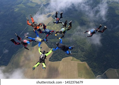 Skydivers are doing a formation in the sky.