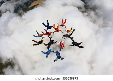 Skydivers are falling above the cloud.