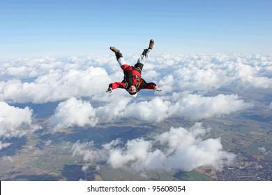 Skydivers flies head down