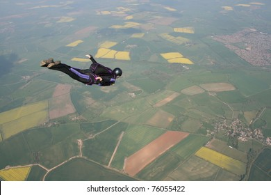 Skydivers flies past cameraman