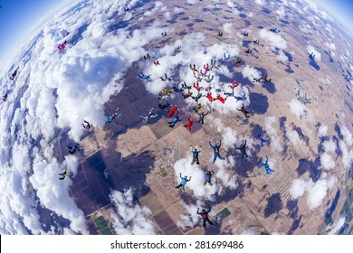 Skydivers in free fall doing a team work jump