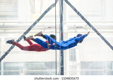 Skydivers in indoor wind tunnel, free fall simulator