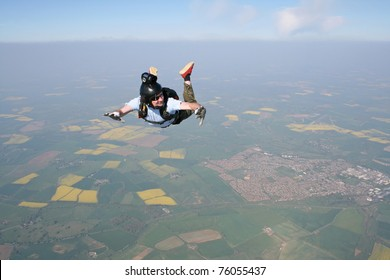 Skydivers looks at his altimeter while in freefall