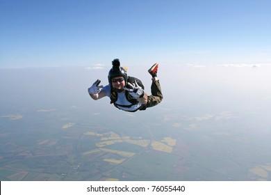 Skydivers waves at the cameraman