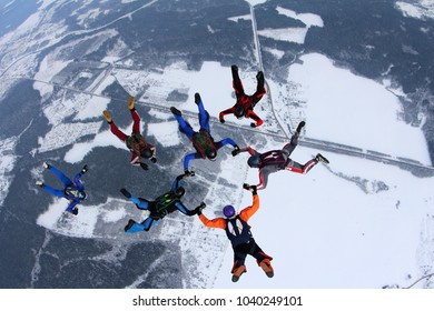 Skydivers in the winter sky.