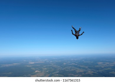 Skydiving. Alone skydiver is in the sky.