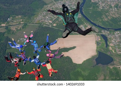 Skydiving. Cameraman makes a photo about formation skydivers.