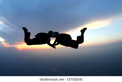 skydiving couple kissing in free fall. Togetherness concept.
