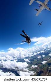 skydiving dive in blue sky