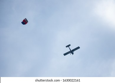 Skydiving -extreme sports- parachutist with a parachute unfolded