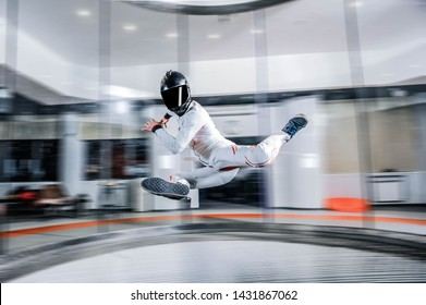 Skydiving. I flying in wind tunnel.Indoor skydiving new  sport in flight technology.