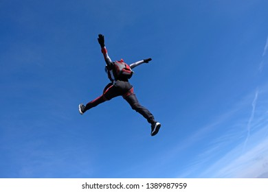 Skydiving. Girl is dancing in the sky.