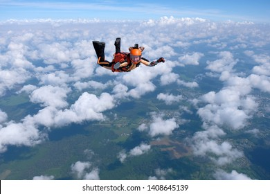 Skydiving. Girl is flying in the sky.