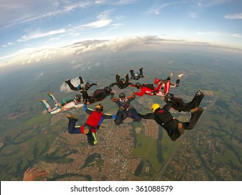 Skydiving group of friends team work