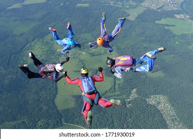Skydiving. A group of skydivers is training in the sky.