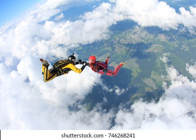 Skydiving. Man and girl are flying in the amazing sky.