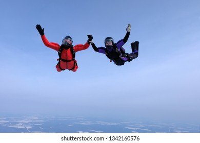 Skydiving. Man and woman are falling together.