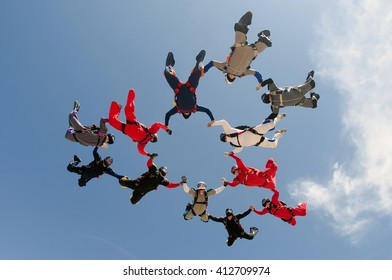 Skydiving people holding hands