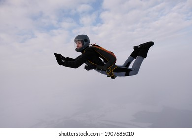 Skydiving. A pretty girl is flying in the  sky.