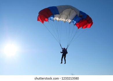 Skydiving. Sportsman is landing.