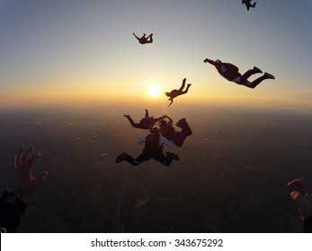 Skydiving at the sunset meeting of friends