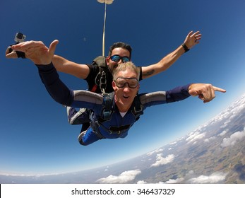 Skydiving tandem happiness middle aged man