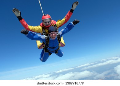 Skydiving. Tandem jumo. Two men are in the sky.