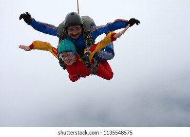 Skydiving. Tandem jump is in the clouds.